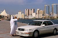 Dubai, United Arab Emirates. Dubai man showing the city to a European businesswoman..