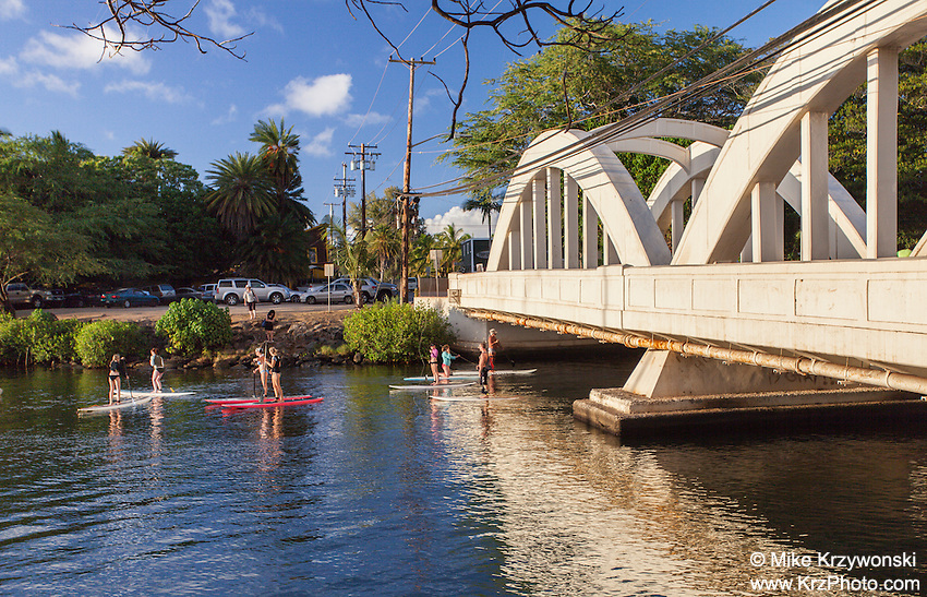 Stand up paddlebarders near Anahulu Stream Bridge in Haleiwa, Oahu, Hawaii