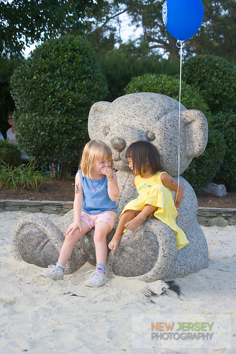 Children at play on a statue in Strawbridge Lake Park, Moorestown, New Jersey