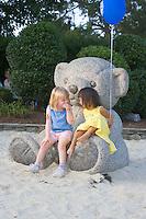 Children at play on a statue in Strawbridge Lake Park, Moorestown, New Jersey