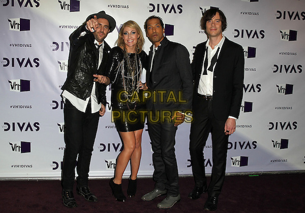 James Shaw, Emily Haines, Josh Winstead & Joules Scott-Key of  Metric.VH1 Divas 2012 held at The Shrine Auditorium, Los Angeles, California, USA..December 16th, 2012.full length dress  black white shirt hat leather necklaces band group hand arm pointing .CAP/ADM/KB.©Kevan Brooks/AdMedia/Capital Pictures.