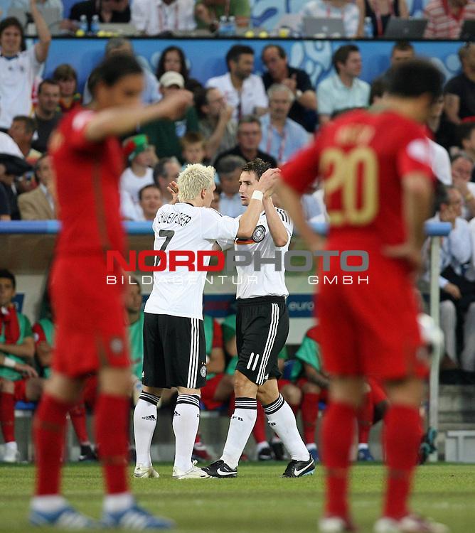UEFA Euro 2008 Quarter-Finals Match 25 Basel - St. Jakob-Park. Portugal ( POR ) - Deutschland ( GER ). <br /> Torsch&uuml;tze Miroslav Klose ( Germany / Angreifer / Forward / Bayern Muenchen #11 ) (M rechts) feiert seinen Treffer zum 2:0 mit Bastian Schweinsteiger ( Germany / Mittelfeldspieler / Midfielder / Bayern Muenchen #07 ) (Mitte l). Die Portugiesen zeigen sich entt&auml;uscht.<br /> Foto &copy; nph (  nordphoto  )