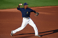 Cedar Rapids Kernels third baseman Jonatan Hinojosa (16) throws to first during a game against the Quad Cities River Bandits on August 18, 2014 at Perfect Game Field at Veterans Memorial Stadium in Cedar Rapids, Iowa.  Cedar Rapids defeated Quad Cities 4-2.  (Mike Janes/Four Seam Images)