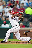 Texas Rangers shortstop Elvis Andrus #1 swings during the Major League Baseball game against the Baltimore Orioles on August 21st, 2012 at the Rangers Ballpark in Arlington, Texas. The Orioles defeated the Rangers 5-3. (Andrew Woolley/Four Seam Images).