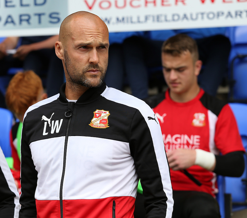 Swindon Town manager Luke Williams looks on before kick off<br /> <br /> Photographer David Shipman/CameraSport<br /> <br /> The EFL Sky Bet League One - Peterborough v Swindon Town - Saturday 3 September 2016 -  ABAX Stadium - Peterborough<br /> <br /> World Copyright &copy; 2016 CameraSport. All rights reserved. 43 Linden Ave. Countesthorpe. Leicester. England. LE8 5PG - Tel: +44 (0) 116 277 4147 - admin@camerasport.com - www.camerasport.com