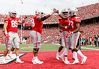 Ohio State Buckeyes offensive lineman Demetrius Knox (78) and quarterback Dwayne Haskins (7) congratulate wide receiver Terry McLaurin (83) after a touchdown during the first quarter of the NCAA football game against the Oregon State Beavers at Ohio Stadium in Columbus on Sept. 1, 2018. [Adam Cairns / Dispatch]