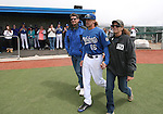 Wildcats' Austin Andrews takes the field with his parents during Sophomore Day ceremonies at Western Nevada College in Carson City, Nev., on Saturday, April 25, 2015. <br /> Photo by Cathleen Allison
