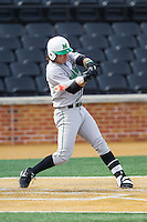 Chase Vogelbach (7) of the Marshall Thundering Herd makes contact with the baseball against the Wake Forest Demon Deacons at Wake Forest Baseball Park on February 17, 2014 in Winston-Salem, North Carolina.  The Demon Deacons defeated the Thundering Herd 4-3.  (Brian Westerholt/Four Seam Images)