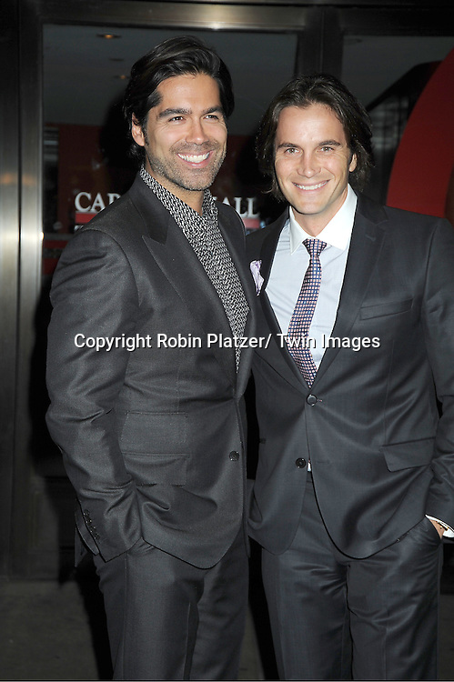 Brian Atwood and guest   attends  the 21st Annual Glamour Magazine Women of the Year Awards on November 7, 2011 at Carnegie Hall in New York City.