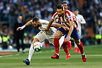 Karim Benzema of Real Madrid and Felipe Augusto de Almeida of Atletico de Madrid