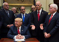 United States President Donald Trump listens as Governor Rick Scott (Republican of Florida) speak after signing S. 544 the Veterans Choice Program Extension and Improvement Act in the Roosevelt Room at the White House in Washington, DC on April 19, 2017. <br /> CAP/MPI/CNP/RS<br /> &copy;RS/CNP/MPI/Capital Pictures