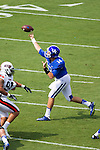 Kentucky Wildcats quarterback Patrick Towles (14) passed for 377 yards as Kentucky beats UT Martin 59-14 in Commonwealth Stadium on August 30, 2014.  Photo by Mark Mahan