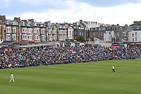 Spectators look on from the terracing during Yorkshire CCC vs Essex CCC, Specsavers County Championship Division 1 Cricket at Scarborough CC, North Marine Road on 6th August 2017
