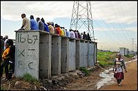 Sitting on top of public toilets, Joe Slovo Squattercamp, Cape Town, SA 2009