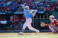 North Carolina Tar Heels catcher Korey Dunbar #43 bats during Game 3 of the 2013 Men's College World Series between the North Carolina State Wolfpack and North Carolina Tar Heels at TD Ameritrade Park on June 16, 2013 in Omaha, Nebraska. The Wolfpack defeated the Tar Heels 8-1. (Brace Hemmelgarn/Four Seam Images)