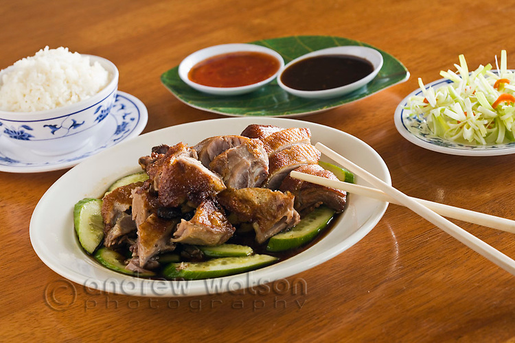Roast duck with steamed rice and dipping sauces.