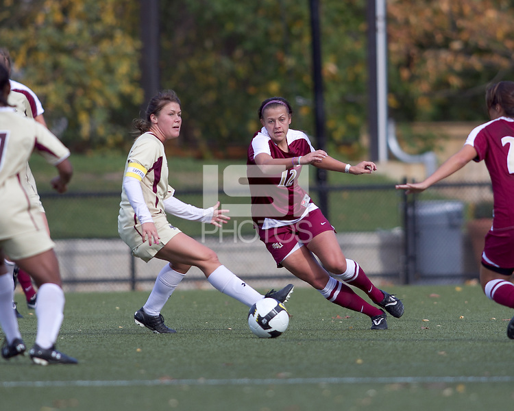 Boston College midfielder Julia Bouchelle (12) attempts to advance the ball as Boston College defender Hannah Cerrone (11) defends. Florida State University defeated Boston College, 1-0, at Newton Soccer Field, Newton, MA on October 31, 2010.