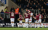 Celebrations as Marc Richards of Northampton Town scores from the penalty spot during the Sky Bet League 2 match between Oxford United and Northampton Town at the Kassam Stadium, Oxford, England on 16 February 2016. Photo by Andy Rowland.