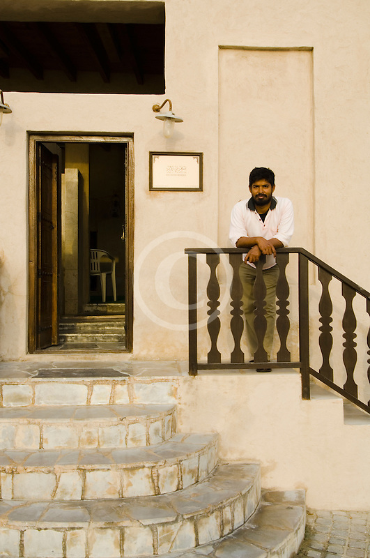 United Arab Emirates, Dubai, Young man on stairway