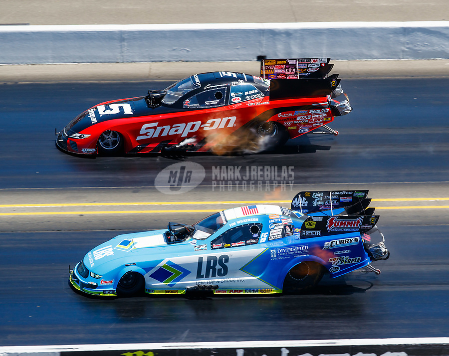 Jul 30, 2017; Sonoma, CA, USA; NHRA funny car driver Tim Wilkerson (near) alongside Cruz Pedregon during the Sonoma Nationals at Sonoma Raceway. Mandatory Credit: Mark J. Rebilas-USA TODAY Sports