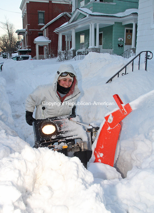 Torrington, CT-020913MK02  Kelly snow blows to clear a path in the heavy snowbank along Main Street in Torrington on Saturday after the storm that dropped over 15 inches in Litchfield County.  The forecast is predicting calm weather today. Michael Kabelka / Republican-American