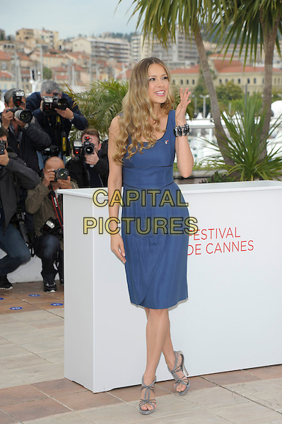 Petra Nemcova.'Haiti Carnival in Cannes' photocall at the 65th  Cannes Film Festival, France 18th May 2012.full length sandals grey gray strappy blue sleeveless dress hand  blowing kiss bracelet gesture .CAP/PL.©Phil Loftus/Capital Pictures.