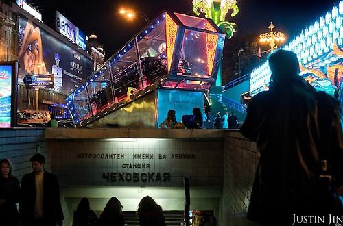 People walk into a metro outside a casino and surrounded by billboards in central Moscow. The Rolls-Royce is the jackpot. Most of the money in Russia is concentrated in Moscow. .