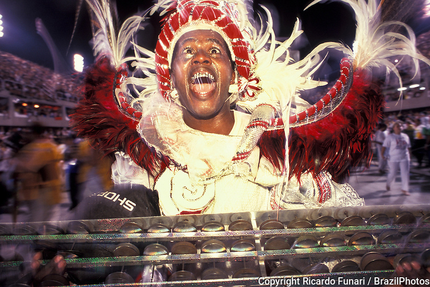Samba Schools Parade, drummer in ecstasy playing samba - Rio de Janeiro Carnival, Brazil.