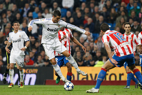13.01.2011 Spanish Copa del Rey from the Santiago Bernebeu. Real Madrid vs At. Madrid 3-1. Picture shows (L) Cristiano Ronaldo fattempts the step over in front of Alvaro Dominguez (R)....