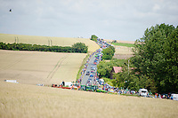 peloton moving through the french landscape<br /> <br /> 2014 Tour de France<br /> stage 4: Le Touquet-Paris-Plage/Lille M&eacute;tropole (163km)