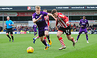 Lincoln City's Shay McCartan vies for possession with Grimsby Town's Luke Hendrie<br /> <br /> Photographer Chris Vaughan/CameraSport<br /> <br /> The EFL Sky Bet League Two - Lincoln City v Grimsby Town - Saturday 19 January 2019 - Sincil Bank - Lincoln<br /> <br /> World Copyright © 2019 CameraSport. All rights reserved. 43 Linden Ave. Countesthorpe. Leicester. England. LE8 5PG - Tel: +44 (0) 116 277 4147 - admin@camerasport.com - www.camerasport.com