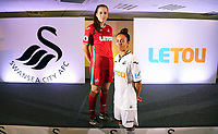 Pictured: Katy Hosford (RED) and Alicia Powe (WHITE) of the Swansea City FC Ladies' team model the home and away kits. Monday 19 June 2017<br />Re: Swansea City FC launch their new home and away kits and announce Letou as their new sponsor at the Liberty Stadium, Swansea, Wales, UK.