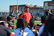 November 22, 2012  (Washington, DC)  Dunbar head coach Jeron Joe talks to his team after their 12-8 win over Anacostia in the 2012 DCIAA Turkey Bowl  (Photo by Don Baxter/Media Images International)