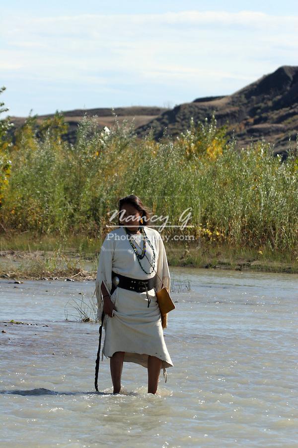 A Native American Indian women standing in a river in South Dakota