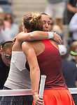 Flavia Pennetta (ITA) (facing camera) hugs   Simone Halep (ROU) after defeating her 6-1, 6-3 in the semifinals at the US Open in Flushing, NY on September 11, 2015.