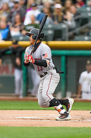 Jae-Gyun Hwang (13) of the Sacramento River Cats follows through on his swing against the Salt Lake Bees during the Pacific Coast League game at Smith's Ballpark on August 11, 2017 in Salt Lake City, Utah. (Stephen Smith/Four Seam Images)