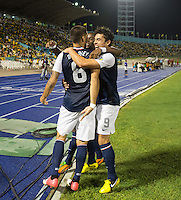 Kingston, Jamaica - Friday, September 7, 2012: The USMNT lost to Jamaica 2-1 during World Cup Qualifying at National Stadium. Clint Dempsey celebrates his goal with Hercules Gomez and Maurice Edu.