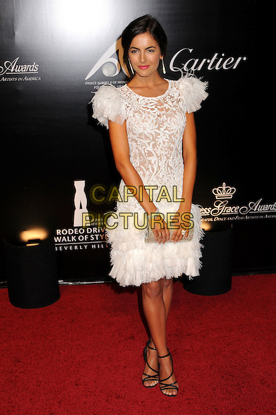 CAMILLA BELLE.Rodeo Drive Walk of Style Award 2009 held on Rodeo Drive, Beverly Hills, California, USA..October 22nd, 2009.full length dress white feather layers layered lace shoulder pads clutch bag silver .CAP/ADM/BP.©Byron Purvis/AdMedia/Capital Pictures.