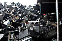 TVs are piled high in a plant that strips the computers of their components in Nanhai, Guangdong, China. The waste plastic will be crushed and recycled. China's voracious demand for commodities including plastic has increased the cost of in the last  couple of years.  .16 Mar 2007