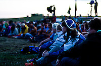 A pair of Finnish IST are enjoying a quiet part of the IST opening ceremony. Photo: Fredrik Sahlström/Scouterna