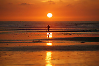 December 23, 2018 - San Diego, California, USA - A runner runs along the waterline at sunset during a low tide at La Jolla Shores Beach.   (Photo Credit: © K.C. ALFRED/ZUMA PRESS)