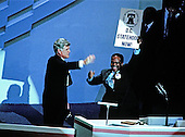 "Atlanta, GA - (FILE) -- United States Senator Edward M. ""Ted"" Kennedy (Democrat of Massachusetts), left, waves as he arrives to make remarks at the 1988 Democratic National Convention in Atlanta, Georgia on July 19, 1988. At right with sign is Washington, D.C. Delegate Walter Fauntroy (Democrat of the District of Columbia).Credit: Arnie Sachs / CNP"