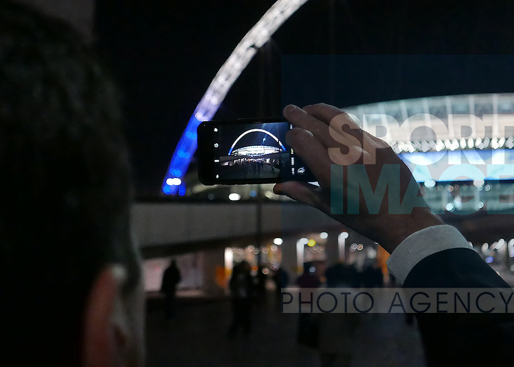 A Spurs fan takes photo of the arch on his mobile phone during the Champions League group E match at the Wembley Stadium, London. Picture date November 2nd, 2016 Pic David Klein/Sportimage