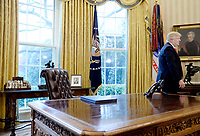 United States President Donald Trump stands in the Oval Office after speaking about trade at the White House March 31, 2017 in Washington, DC. Photo Credit: Olivier Douliery/CNP/AdMedia