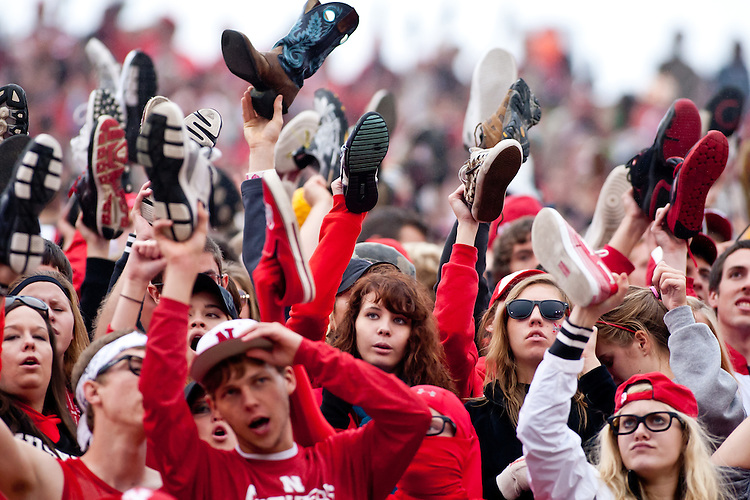 17 Sept 2011: Nebraska students hold up their shoes for a Nebraska kick-off to Washington in the fourth quarter at Memorial Stadium in Lincoln, Nebraska. Nebraska defeated Washington 51 to 38.