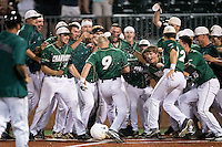 Brett Netzer (9) of the Charlotte 49ers is greeted at home plate by his teammates after hitting a walk-off home run in the bottom of the 9th inning against the Wake Forest Demon Deacons at Hayes Stadium on March 16, 2016 in Charlotte, North Carolina.  The 49ers defeated the Demon Deacons 7-6.  (Brian Westerholt/Four Seam Images)