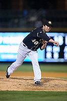 Charlotte Knights relief pitcher Daniel Webb (40) follows through on his delivery against the Toledo Mud Hens at BB&T BallPark on April 27, 2015 in Charlotte, North Carolina.  The Knights defeated the Mud Hens 7-6 in 10 innings.   (Brian Westerholt/Four Seam Images)
