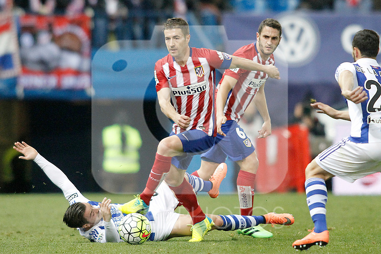Atletico de Madrid's Gabi Fernandez (c) and Koke Resurrecccion (r) and Real Sociedad's Hector Hernandez during La Liga match. March 1,2016. (ALTERPHOTOS/Acero)