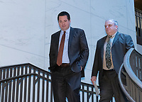 United States Representative Devin Nunes (Republican of California), Ranking Member, US House Permanent Select Committee on Intelligence, left, returns from a series of votes as Michael Cohen, former attorney to United States President Donald J. Trump, continues to testify in a closed hearing before the before the committee on Capitol Hill in Washington, DC on Wednesday, March 6, 2019. Photo Credit: Ron Sachs/CNP/AdMedia