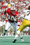 University of Wisconsin defensive lineman (99) Erasmus James during the West Virginia University game at Camp Randall Stadium in Madison, WI, on 9/7/02. The Badgers beat West Virginia 34-17.  (Photo by David Stluka)